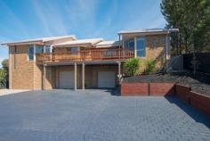 2 Gleneagles Ct Darley VIC 3340 $535,000 Located in a quiet pocket of the stunning Links estate is a classy 3 bedroom home set on a mammoth 1200 sqm (approx.) block with plenty to offer for the whole family. Let's start with the garage, spacious enough to hold 5 cars, it is huge! Plenty of room to use it as a workshop and it even has a mountain of space under the house to store items or to convert to a cellar! Internal access from the garage to the lower level of the home could be used as a study, small living area or even a games room. The first thing you notice when you make your way upstairs is the sophisticated polished timber boards throughout, giving the home a light and elegant feel. The expansive kitchen overlooks the picturesque views of Bacchus Marsh and is fully equipped with Stainless Steel appliances including a built in Microwave, Dishwasher, 900mm Cooktop and Wall oven. Great sized pantry and stone benchtops, this is a MasterChef's dream! Not only is there a meals area right next to the kitchen, there is also a formal dining area which could also be used as a living space. Come summertime, entertaining guests is a breeze! You have plenty of options, the oversized decking area with merbau decking is simply amazing as is the solar heated in ground pool, both of which overlook the township and its picturesque views. Property Overview Property ID: 1P2469 Property Type: House Land Size: 1200m² approx. Garage: 5