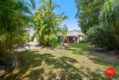 24 Loaders Ln Coffs Harbour NSW 2450 $899,000 - $949,000 Set on just over 2500m2 this private and spacious home is sure to impress. Only minutes from the CBD of Coffs Harbour, this is a rare find in the current market and will certainly appeal to a large range of buyers. The home itself is very spacious and includes multiple living zones and large bedrooms. The main bathroom has recently been renovated and is finished with floor to ceiling tiles and quality fixtures and fittings. The kitchen is original but in very good condition and comes with solid granite benchtops and modern appliances. The functional floor plan has been designed with the family in mind and one end of the house is great for kids or guests and can be closed off from the rest of the house and made fully self contained. The master bedroom with ensuite is privately tucked away at the opposite end of the house and looks over the private rear lawn and gardens. For the entertainer this home is perfect with a huge living area that can be opened up on both sides with a sparkling inground pool on one side and the beautiful greenery of the park like gardens on the other side. For those craving space and privacy this home has got the lot with a mostly level rear yard leading down to the picturesque creek as your rear boundary. Extra vehicles are also well catered for with a 4 bay lock up shed, carport for a large caravan or boat, plus another double carport in front of the house and there is also side access to the rear yard. This is a once in a lifetime opportunity to secure a large house on a large parcel of land in such a convenient location. Don't hesitate as this one will not last long!