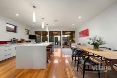 35 John Liston Dr Newport VIC 3015 $1,150,000 - $1,250,000 The entertainer's delight Entertaining will be a dream in this sleek, large 3-bedroom family home located in the highly sought-after Williamstown Junction. You'll be toasty warm from the moment you walk in with the gas log heater welcoming you into the large front lounge room which includes French doors that open out to the front courtyard. Follow the stunning timber floors, past the peaceful sounds of a waterfall in the enchanting atrium, to the spacious living area. A huge modern kitchen with a motherload of cupboard space and walk in pantry, includes stainless steel Miele appliances and a large Caesarstone island bench just itching for entertaining. Your dinner guests can relax in here or wander out to the huge alfresco wooden decking area, covered and fitted with its own bar heating and cafe blinds, offers enjoyment all year round. Head upstairs and you'll find two good sized bedrooms with BIRs, one with a split system, both sharing a large bathroom with shower, toilet and bath as well as the light filled master bedroom with a walk-in robe, split system and ensuite with spa bath, shower and toilet. Fling open the French doors each morning to greet the sun from your very own petite balcony or just enjoy the views of the park across the road. As if all that is not enough, this house features ducted heating throughout, along with three split systems and evaporative cooling keeping it comfortable all year round, and Bose speakers with surround sound just ready for your amp to be plugged in. A large rear access double garage and, wait for it, ladder leading to a massive loft with oodles of storage space to hide away everything that comes with family living are just the icing on the cake. Situated minutes walking distance from the bustling Newport shops and cafes, 10 minutes from schools and 7 minutes to Newport train station - you couldn't be closer to the action. The only problem you'll have is where to sit 