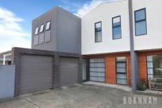 3/32 Burns Street Maidstone VIC 3012 $790,000 - $840,000 This three-bedroom townhouse epitomises spacious and bright living; wrapped up in one of the most desirable streets in Maidstone. Space poses no issue in the dining and lounge area of the home, where large floor to ceiling windows that face out upon the large backyard allow for light to fill the room. A study nook accompanies this space. Enjoy cooking with ease in the stylish and sleek kitchen, with stone benchtops, a double sink, an abundance of cabinets, tiled splashback, chrome accents, European gas appliances and an island bench. A central powder room and separate laundry with backyard access completes this lower level. Newly carpeted stairs guide you to the upper level of the home. The enormous master suite has a prodigious walk-in robe that fulfils all your storage needs and a generous ensuite complete with an oversized shower and vast vanity space. The second and third bedrooms are large, and light filled and are both serviced by double built-in robes. The upper level is completed by a central bathroom with a tub, extended vanity space and ample storage. Located less than 10kms from Melbourne's city, a range of amenities are made readily available to you. Indulge yourself at the many surrounding cafes and restaurants, unleash the shopaholic within at Highpoint Shopping Centre, travel from the nearby bus/tram stops or immerse yourself in nature at the Maribyrnong River and multiple parklands/reserves close by. Additional features: – Separate laundry with backyard access – Security camera and intercom – Double garage with internal access – Split system heating and cooling in lounge area, master bedroom and upper level – Generous and low-maintenance backyard..