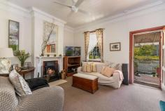 16 Taloumbi Street Maclean NSW 2463 $490,000 - $510,000 This quaint and very charming cottage is located in a prime position within the sought after riverside town of Maclean. The home is spacious in size and is only a short stroll to the Maclean CBD or a hop skip and a jump to the famous Botero coffee Cafe where you can duck out for a fabulous coffee, Breaky or Lunch. The cottage offers 3 bedrooms, a study plus stairs that lead to a loft area with raked ceilings and could be utilized as a 4th bedroom or 2nd living area. The lounge room has high ceilings with a lovely ornate fireplace and the kitchen is neat and boasts a brick feature wall with a separate dining area. The bathroom has been updated and there is a 2nd toilet located on the side verandah. Set on a small 338.7m2 manageable block with low maintenance gardens and yard this attractive old world home is complete with a picket fence and a wide verandah off the front and side of the home where you can sit and watch the world go by.