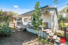 2 Church Street Nana Glen NSW 2450 $539,000 - $569,000 This charming country cottage is the ideal place to start if you want to live off grid & enjoy this most beautiful little paradise of your own. Live like you are a million miles from the rest of the world, yet have the convenience of being a few hundred meters from everything you need. The corner store, bottle shop, cafe, pharmacy, local primary school & pre-school, service station, playing fields & swimming holes are all within a short walk from your home. All this & situated in the end of a quiet country cul-de-sac, just 25 minutes drive to the thriving city of Coffs Harbour & 20 mins to the beach. From the white picket fence at the front, to the beautiful crystal clear stream at the rear, this delightful property has so many quaint aspects you will love. Those wanting to live off grid & eat of the produce from your own land will appreciate all that's been done here to set up a lifestyle you can reap the benefits of for many years to come. With approximately 40 different types of fruit trees & food producing plants in the garden, the foundation has been laid for the keen gardener. From your sunny back verandah deck, there is nothing but the serene green valley & views as far as the eye can see. Looking out on the misty mornings over the paddocks & across the stream is a picture that dreams are made of. A shady, treed covered corner of the garden will be the children's magical wonderland to play in for hours on end - complete with a treehouse overlooking the nearby stream & farmland. Original hardwood floors & fireplace will appeal to those who love character & a relaxed cozy country feel. If you are longing for a simpler life and want to return to the land without having to buy the big acreage to do it, this property will certainly fit your requirements on many levels.