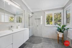 114 Forest Drive Repton NSW 2454 $1,700,000 - $1,800,000 Located at the end of the street and bordering National Park at the rear, this amazing property has one of the most private and tranquil settings of any property on the Coffs Coast. Approximately 15 mins drive from the Coffs Harbour CBD and minutes to nearby local beaches this property offers amazing convenience yet feels as if you are a world away from anywhere. Set back from the road and hidden behind a wall of green the home itself is positioned on almost 5 acres of bush and rainforest. The home was designed by the current owners and has been a labour of love for almost 40 years where they have created a peaceful environment with beautiful gardens, lush lawns and tranquil views. Once inside the home a contemporary renovation has recently been completed and no expense has been spared. From the stone look tiles and timber floors to the quality bathrooms and the spectacular kitchen this property has so many special features that it is impossible to list them all. A split level design with raked ceilings and feature windows offers plenty of natural light and there are tranquil views everywhere. The parents retreat or master suite was an addition to the home and offers the lucky purchaser their own escape with a private study, separate sitting area and its own private balcony. The renovated ensuite has only recently been completed and includes a curved glass shower screen, floor to ceiling tiles and quality fixtures. Step down to the main living/dining area and prepare to be impressed with the polished timber floors, wood fireplace, feature pendant lighting and the most amazing picture window that looks over the simply stunning 12m concrete pool. The kitchen is also on this level and has been finished to a very high standard with custom granite benchtops, and quality appliances. As you move outside onto one of the largest outdoor entertaining areas I have ever seen you will be captivated by the beautiful bush ou